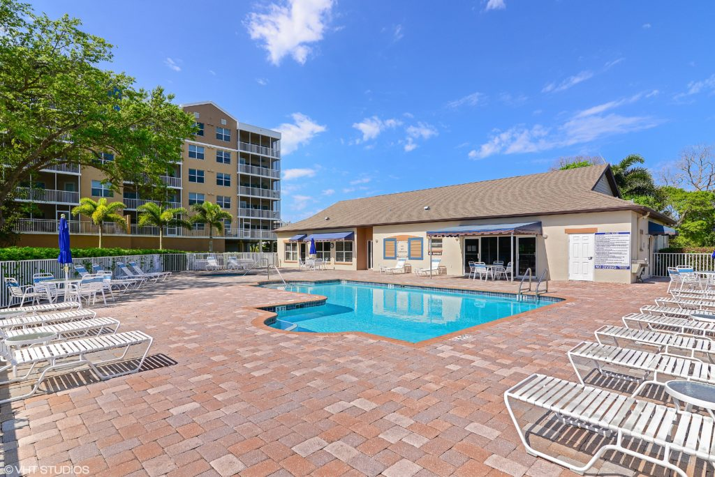 The resort style Clubhouse with pool and hot tub for exclusive resident's use, Golf Lake Condos at East Bay